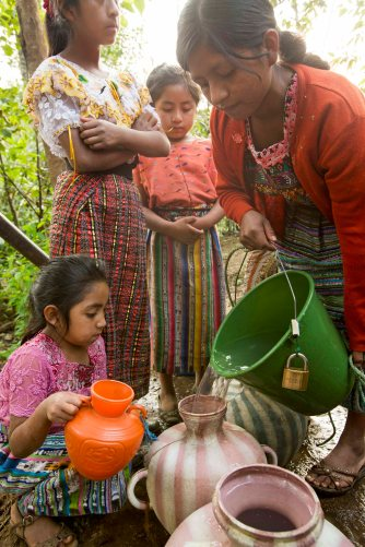 Women and children in Sacala Las Lomas, Guatemala fetch water. Women can spend up to 5 hours a day fetching water. Soon, the men in this community will dig five and a half miles of trench to provide the piping structure for a new gravity fed water system funded by a Rotary Foundation global grant. Partnered with Berhorst and Rotary clubs, the community will build a system that delivers clean to the home. Women and children will no longer need to travel hours per day carrying heavy tinajas to and from a contaminated well.